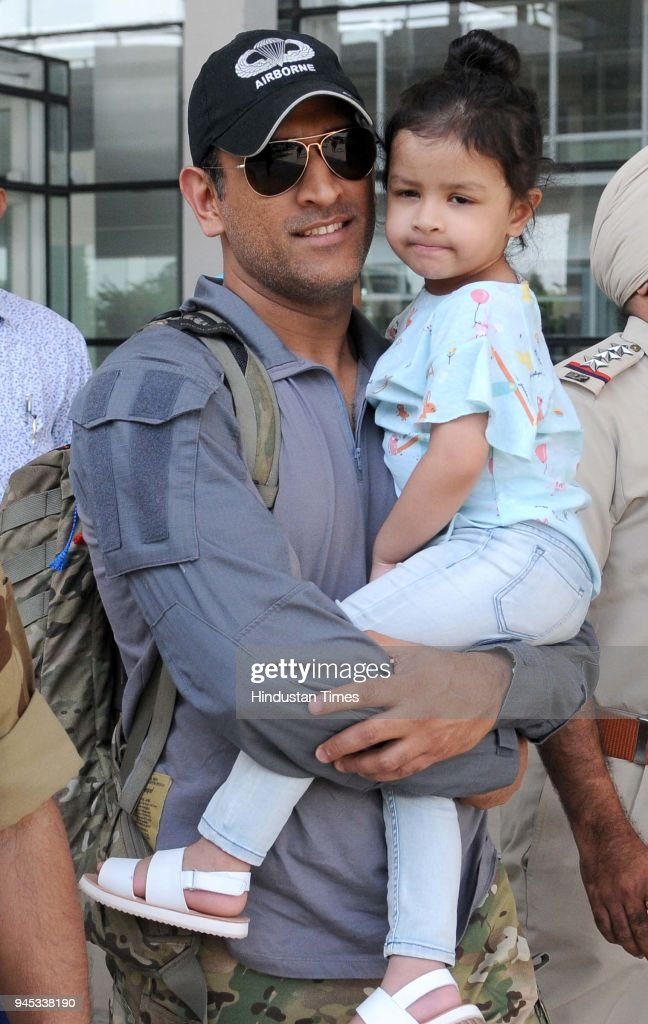 Dhoni of Chennai Super Kings team along with daughter coming out from the Chandigarh airport on April 12 2018 in Chandigarh India