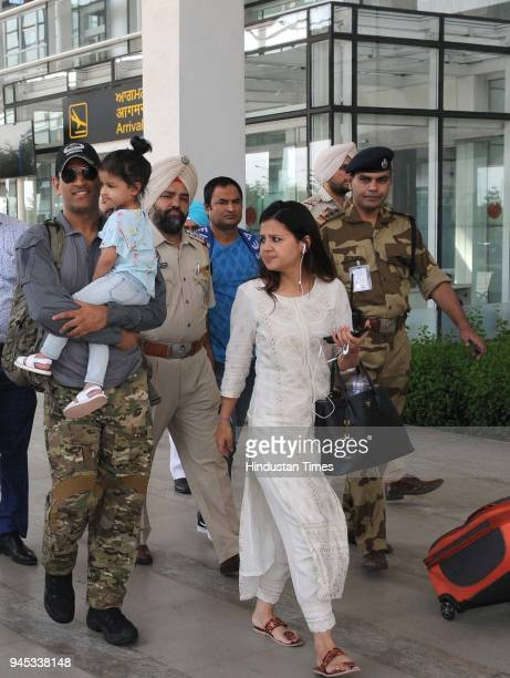 Dhoni of Chennai Super Kings team along with his wife Sakshi Dhoni and daughter coming out from the Chandigarh airport on April 12 2018 in Chandigarh...