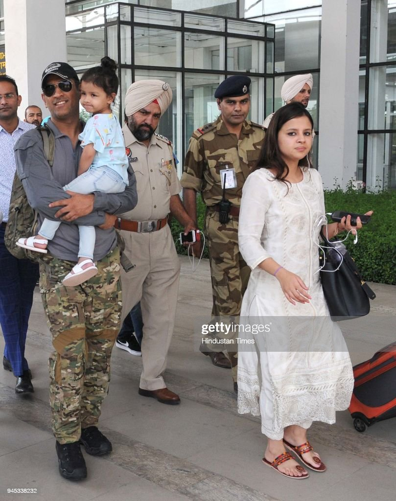 Dhoni of Chennai Super Kings team along with his wife Sakshi Dhoni and daughter coming out from the Chandigarh airport on April 12 2018 in Chandigarh.