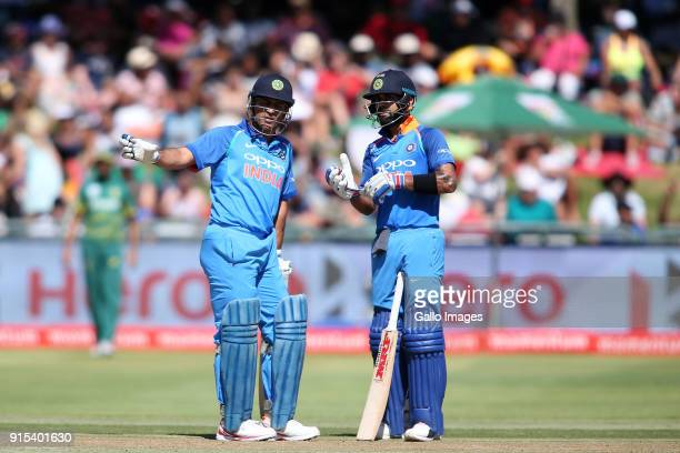 Dhoni of India and Indian captain Virat Kohli during the 3rd Momentum ODI match between South Africa and India at PPC Newlands on February 07 2018 in...