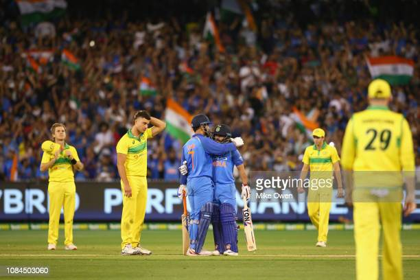 Dhoni of India and Kedar Jadhav of India celebrate after winning game three and series of the One Day International series between Australia and...