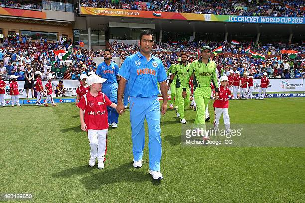 Dhoni of India and Shahid Afridi of Pakistan walk out with the LG mascots during the 2015 ICC Cricket World Cup match between India and Pakistan at...