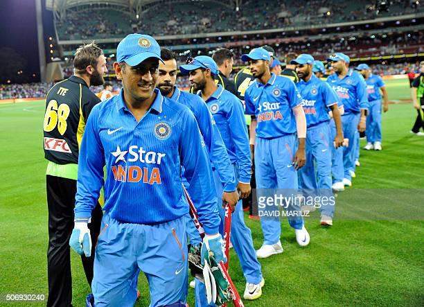 MS Dhoni of India and teammate shake hands with Australian players after their victory in the first Twenty20 cricket international between India and...