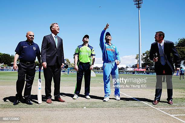 Dhoni of India and William Porterfield of Ireland at the coin toss prior to the 2015 ICC Cricket World Cup match between Ireland and India at Seddon...