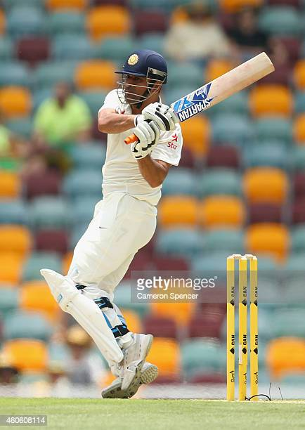 Dhoni of India bats during day two of the 2nd Test match between Australia and India at The Gabba on December 18, 2014 in Brisbane, Australia.