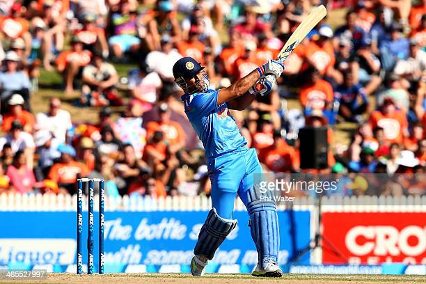 Dhoni of India bats during game four of the men's one day international series between New Zealand and India at Seddon Park on January 28 2014 in...