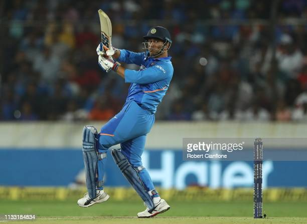 Dhoni of India bats during game one of the One Day International series between India and Australia at Rajiv Gandhi International Cricket Stadium on...