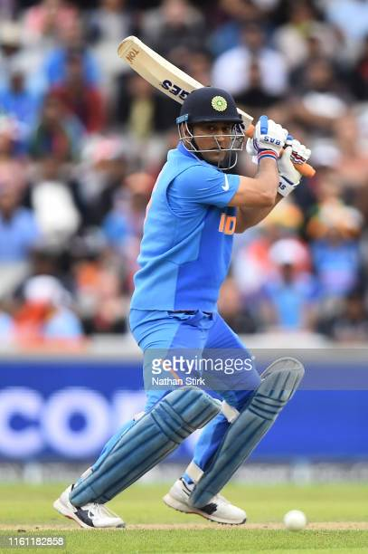 Dhoni of India bats during resumption of the SemiFinal match of the ICC Cricket World Cup 2019 between India and New Zealand after weather affected...