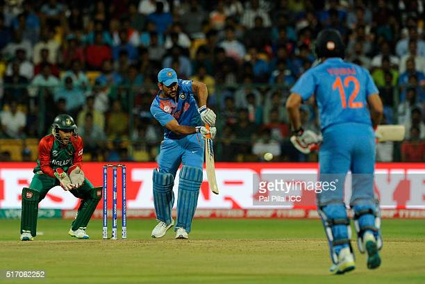 M S Dhoni of India bats during the ICC World Twenty20 India 2016 match between India and Bangladesh at the Chinnaswamy stadium on March 23 2016 in...