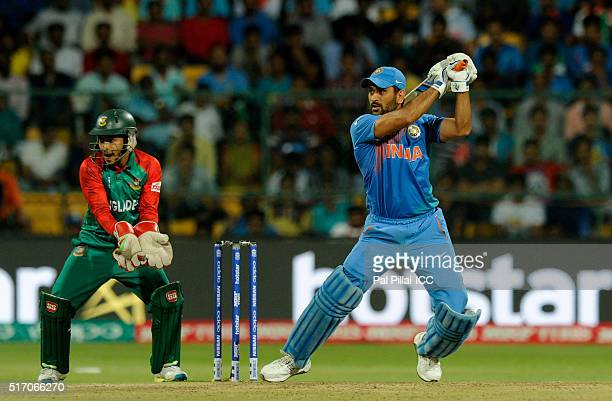 Dhoni of India bats during the ICC World Twenty20 India 2016 match between India and Bangladesh at the Chinnaswamy stadium on March 23 2016 in Mumbai...