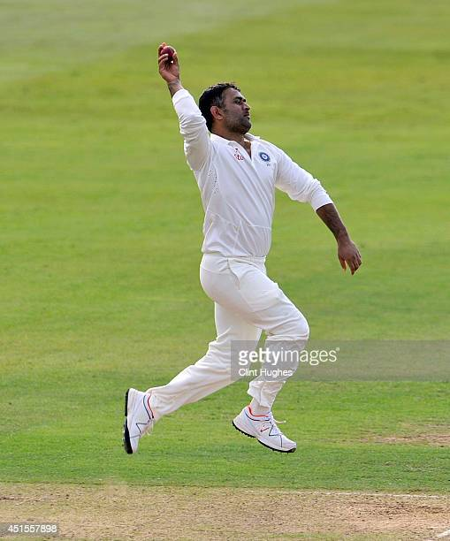 Dhoni of India bowls during day one of the tour match between Derbyshire and India at The 3aaa County Ground on July 1 2014 in Derby England