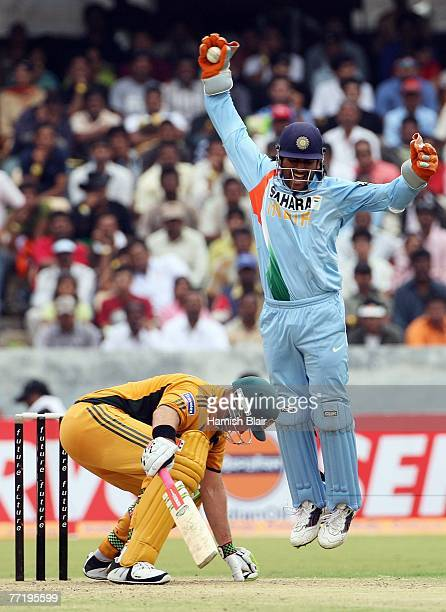 Dhoni of India celebrates his catch to dismiss Matthew Hayden of Australia during the third one day international match between India and Australia...