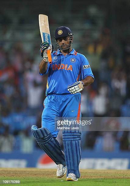Dhoni of India celebrates his century during the 2011 ICC World Cup Warm up game against India and New Zealand at the MA Chidambaram Stadium on...