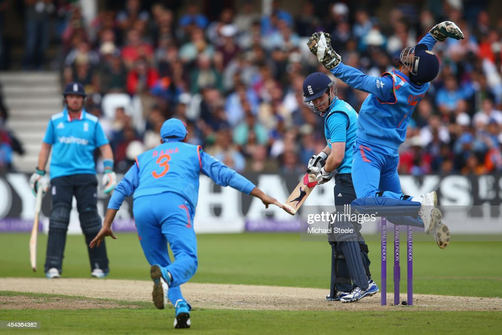 MS Dhoni of India celebrates taking a catch to dismiss Eoin Morgan of England off the bowling of Ravichandran Ashwin during the third Royal London One-Day Series match between England and India at Trent Bridge on August 30, 2014 in Nottingham, England.