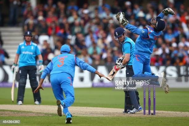 Dhoni of India celebrates taking a catch to dismiss Eoin Morgan of England off the bowling of Ravichandran Ashwin during the third Royal London...