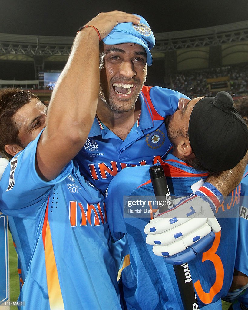 MS Dhoni (C) of India celebrates victory with team mates Suresh Raina (L) and Harnhajan Singh after the 2011 ICC World Cup Final between India and Sri Lanka at Wankhede Stadium on April 2, 2011 in Mumbai, India.