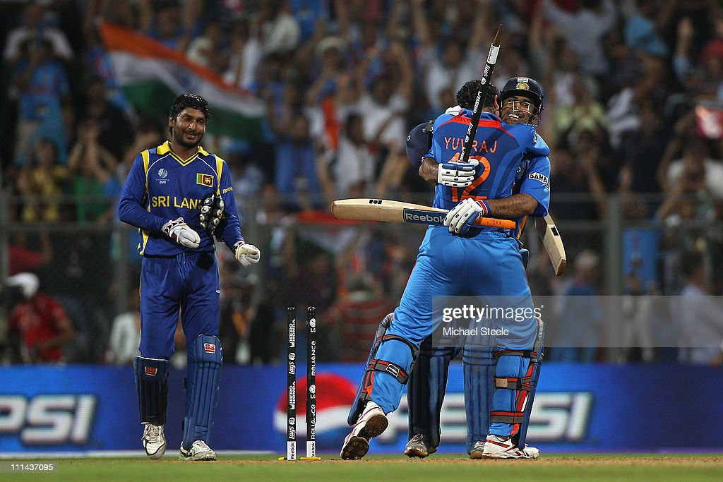 MS Dhoni (R) of India celebrates with Yuvraj Singh after hitting a six to win by six wickets as Kumar Sangakkara (L) captain of Sri Lanka looks on during the 2011 ICC World Cup Final between India and Sri Lanka at Wankhede Stadium on April 2, 2011 in Mumbai, India.