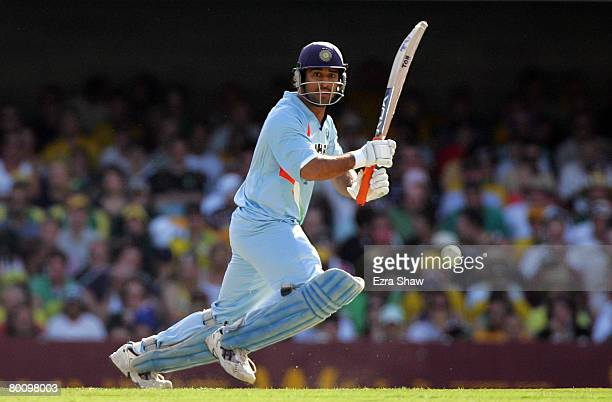Dhoni of India cover drives during the Commonwealth Bank Series One Day International second final match between Australia and India at the Gabba on...
