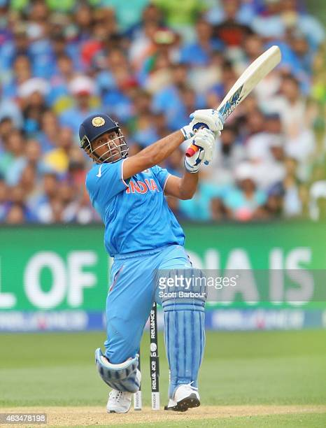 Dhoni of India hits a six during the 2015 ICC Cricket World Cup match between India and Pakistan at Adelaide Oval on February 15 2015 in Adelaide...