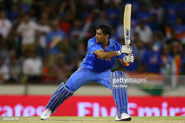 Dhoni of India hits the winning runs during the 2015 ICC Cricket World Cup match between India and the West Indies at WACA on March 6 2015 in Perth...