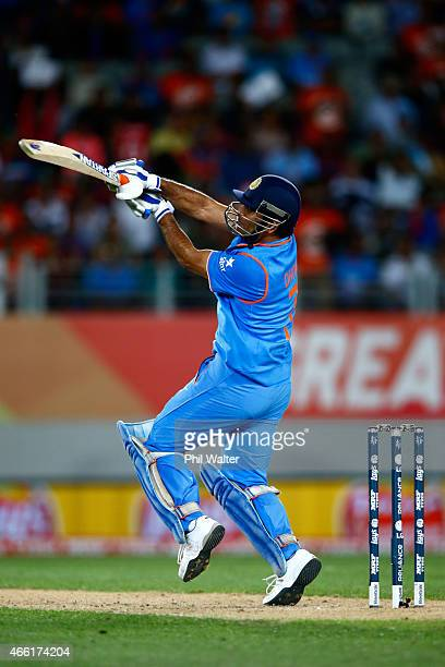 Dhoni of India hits the winning runs during the 2015 ICC Cricket World Cup match between India and Zimbabwe at Eden Park on March 14 2015 in Auckland...