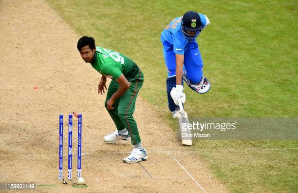 Dhoni of India is run out as Mustafizur Rahman of Bangladesh looks on during the Group Stage match of the ICC Cricket World Cup 2019 between...