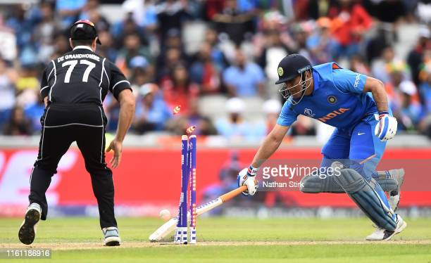 Dhoni of India is run out by Martin Guptill of New Zealand during resumption of the SemiFinal match of the ICC Cricket World Cup 2019 between India...