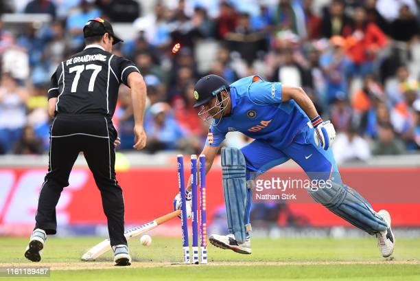 Dhoni of India is run out by Martin Guptill of New Zealand during resumption of the Semi-Final match of the ICC Cricket World Cup 2019 between India...