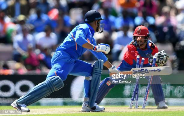Dhoni of India is stumped by Ikram Ali Khil of Afghanistan during the Group Stage match of the ICC Cricket World Cup 2019 between India and...
