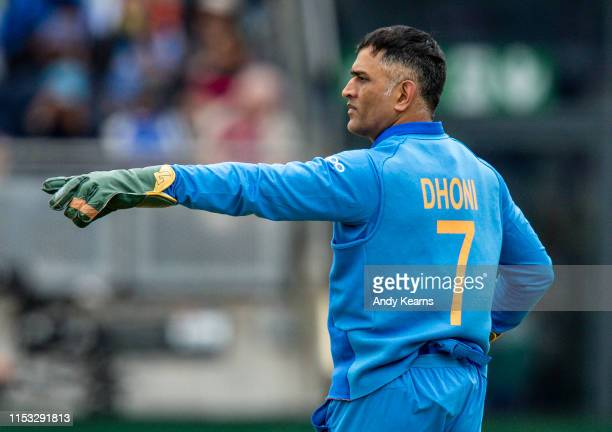 Dhoni of India issues instructions during the Group Stage match of the ICC Cricket World Cup 2019 between Bangladesh and India at Edgbaston on July...