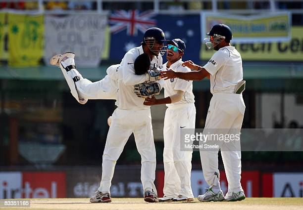 Dhoni of India jumps on top of Harbhajan Singh of India after Singh dismissed Mike Hussey of Australia during day four of the Second Test match...