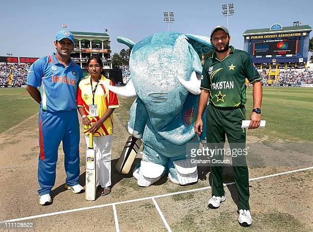 Dhoni of India Lays Competition winner Arancha Stumpy the mascot and Shahid Afridi of Pakistan pose before the 2011 ICC World Cup second SemiFinal...
