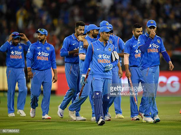 MS Dhoni of India leads his team off the pitch after beating Australia in the second Twenty20 international cricket match between Australia and India...