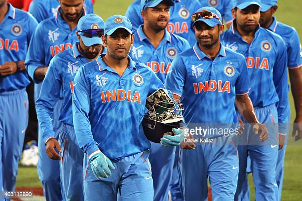Dhoni of India leads the team off the field after the 2015 ICC Cricket World Cup warm up match between India and Afghanistan at Adelaide Oval on...