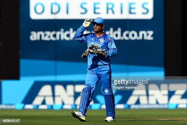 Dhoni of India leaves the field at the end of the New Zealand innings during the first One Day International match between New Zealand and India at...
