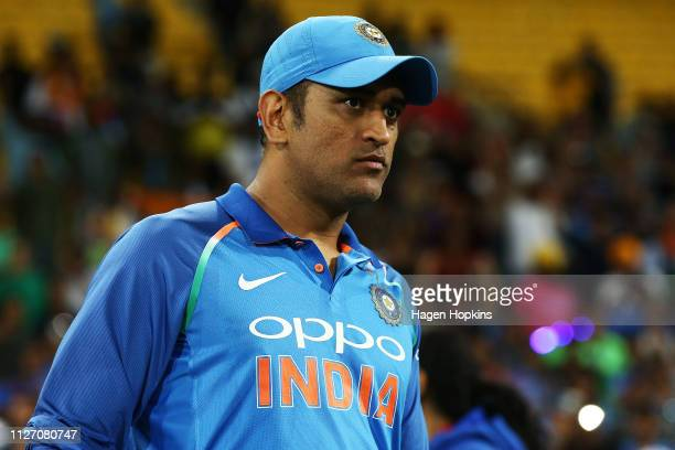 Dhoni of India looks on during game five in the One Day International series between New Zealand and India at Westpac Stadium on February 03, 2019 in...