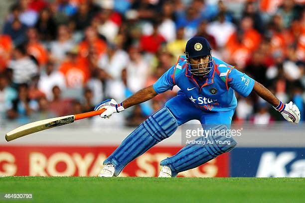 Dhoni of India makes his run during the One Day International match between New Zealand and India at Eden Park on January 25 2014 in Auckland New...