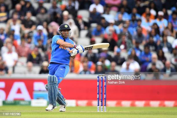 Dhoni of India plays a pull shot during resumption of the SemiFinal match of the ICC Cricket World Cup 2019 between India and New Zealand after...