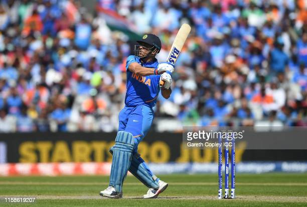 Dhoni of India plays a shot for six during the Group Stage match of the ICC Cricket World Cup 2019 between West Indies and India at Old Trafford on...