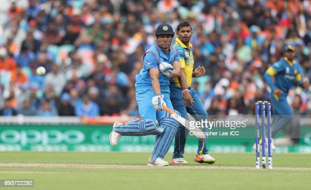 Dhoni of India runs into Asela Gunaratne of Sri Lanka during the ICC Champions Trophy Group B match between India and Sri Lanka at The Kia Oval on...