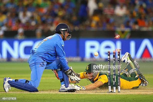 Dhoni of India runs out David Miller of South Africa during the 2015 ICC Cricket World Cup match between South Africa and India at Melbourne Cricket...