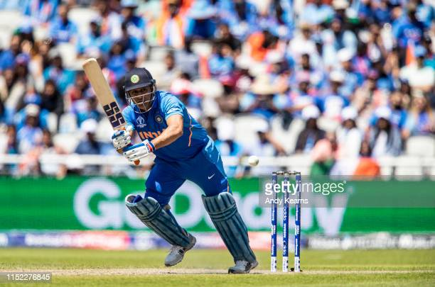 Dhoni of India sets off for a run during the Group Stage match of the ICC Cricket World Cup 2019 between West Indies and India at Old Trafford on...