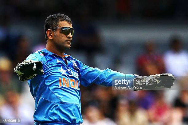 Dhoni of India settles down his team during the One Day International match between New Zealand and India at Eden Park on January 25 2014 in Auckland...