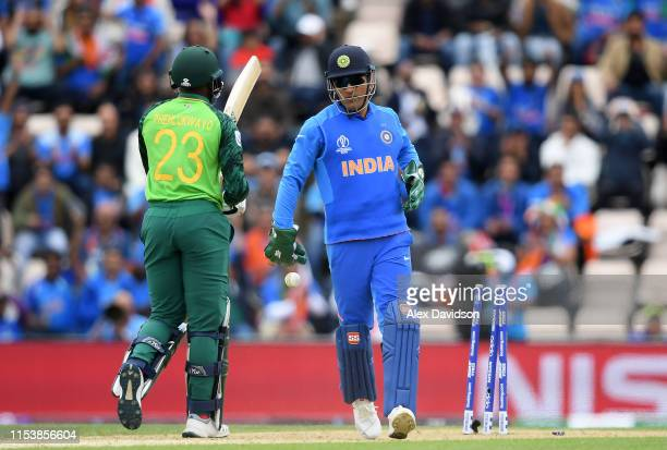 Dhoni of India stumps Andile Phehlukwayo of South Africa during the Group Stage match of the ICC Cricket World Cup 2019 between South Africa and...