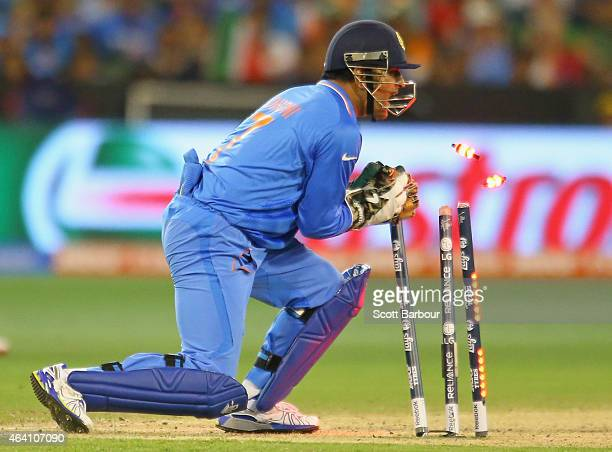 Dhoni of India takes the bails off to run out AB de Villiers of South Africa during the 2015 ICC Cricket World Cup match between South Africa and...