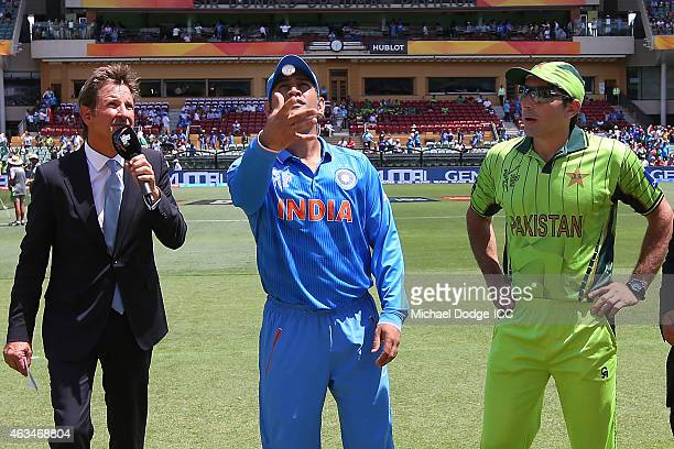 Dhoni of India tosses the coin next to Shahid Afridi of Pakistan during the 2015 ICC Cricket World Cup match between India and Pakistan at Adelaide...