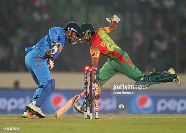 Dhoni of India unsuccessfully attempts to run out Anamul Haque of Bangladesh during the ICC World Twenty20 Bangladesh 2014 match between Bangladesh...