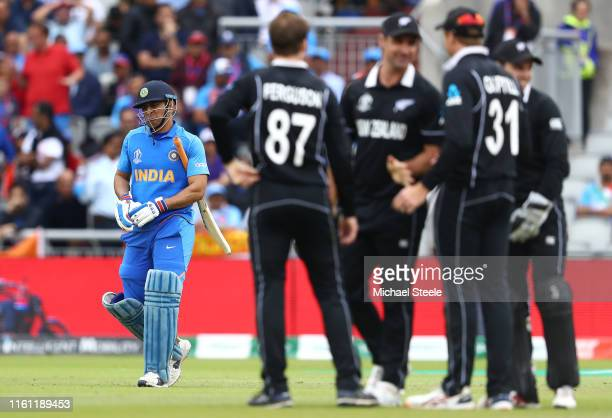Dhoni of India walks as he is run out by Martin Guptill of New Zealand during resumption of the SemiFinal match of the ICC Cricket World Cup 2019...