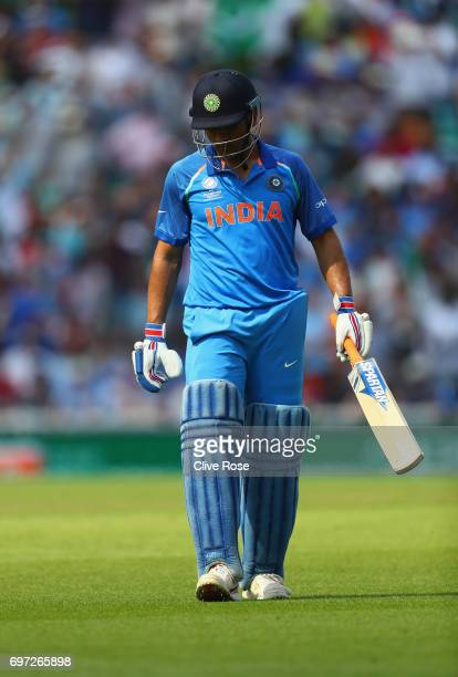 Dhoni of India walks from the field after eing dismissed during the ICC Champions trophy cricket match between India and Pakistan at The Oval in...