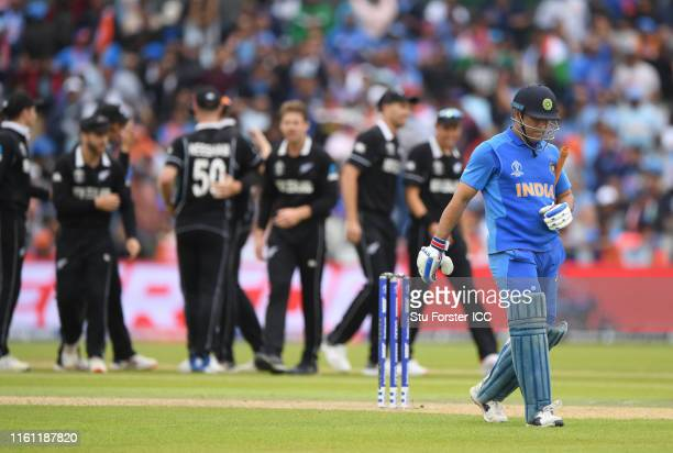 Dhoni of India walks off after being dismissed during the Semi-Final match of the ICC Cricket World Cup 2019 between India and New Zealand at Old...